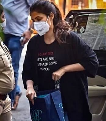 Rhea Chakraborty makes a statement with her T-shirt as she arrives for questioning at the Narcotics Control Bureau. (Source: Instagram)