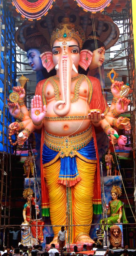 A 60-feet high idol of lord Ganesh, claimed to be the highest in Telangana being installed at Khairatabad in Hyderabad on Aug 28, 2014.