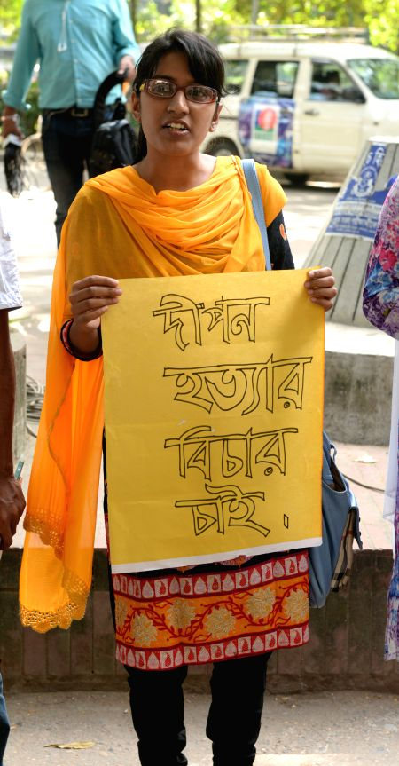 A Bangladeshi student holds a poster during a protest rally against the killing of Bangladeshi publisher Faisal Arefin Dipan, who was murdered in an attack by ...
