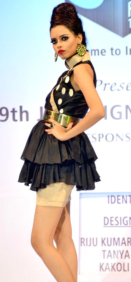 A models walks the ramp during 9th JD Design Fest 2014 at ITA Machkhowa centre in Guwahati  on July 27, 2014.
