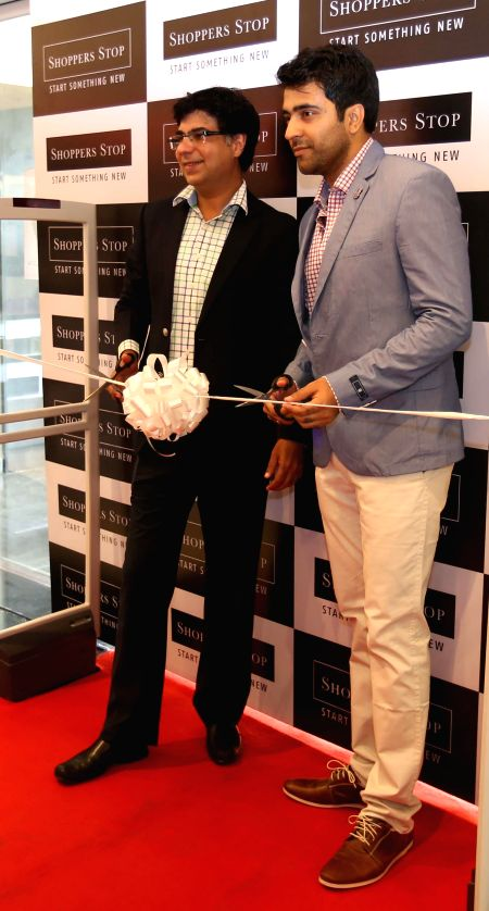 Actor Abir Chatterjee and Shoppers Stop Ltd. Customer Care Associate & Senior Vice President Marketing & Loyalty Vinay Bhatia during the launch of a store in Kolkata on May 9, 2014.