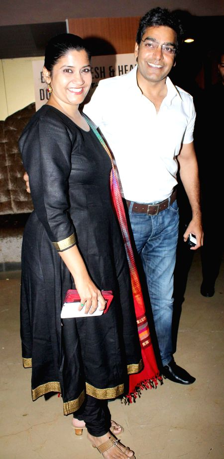 Actors Renuka Shahane and Ashutosh Rana during the special screening of film Humpty Sharma ki Dulhania in Mumbai on July 10, 2014. - Renuka Shahane and Ashutosh Rana