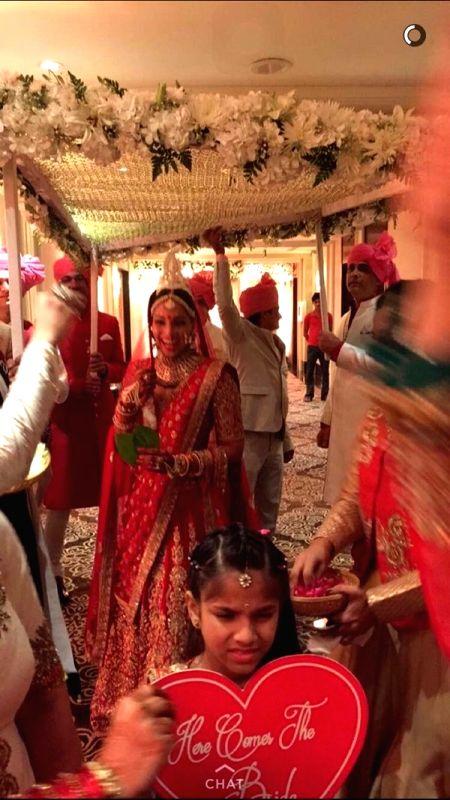 Actress Bipasha Basu dressed as a true Bengali bride during her wedding ceremony in Mumbai on April 30, 2016. - Bipasha Basu