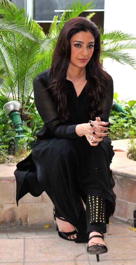 Actress Tabu during a photo shoot organised to promote her upcoming film `Drishyam`  in New Delhi, on July 28, 2015. - Tabu