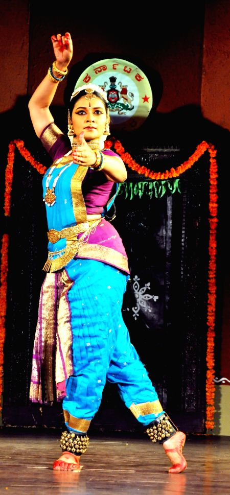 An artist performs during a programme - 'Housefull' organised in honour of Dr. Rajkumar in Bangalore on April 25, 2014.