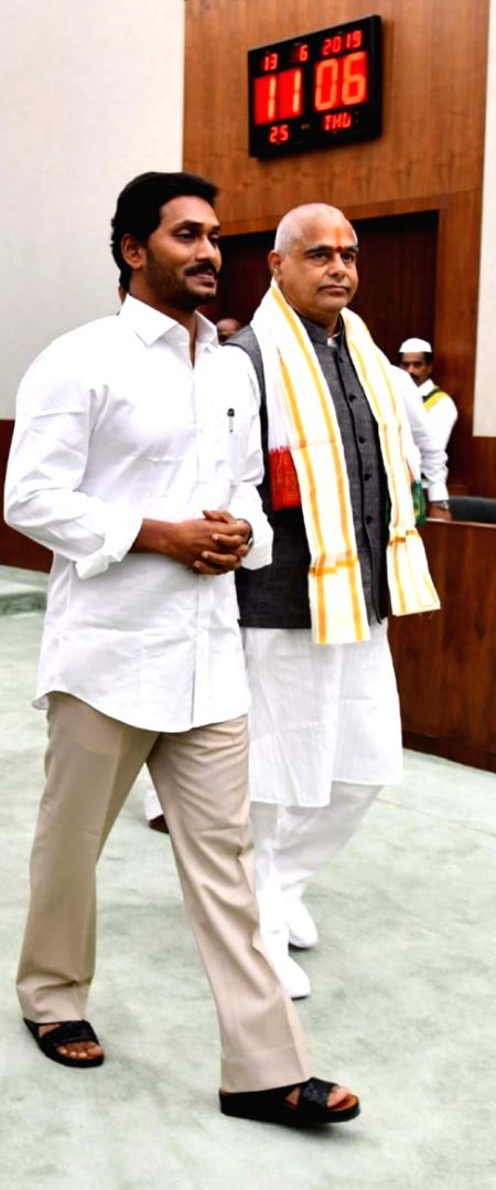 Andhra Pradesh Chief Minister Y.S. Jagan Mohan Reddy with the newly elected Andhra Pradesh Legislative Assembly Speaker Thammineni Seetharam on the second day of the first session of the ... - Y.