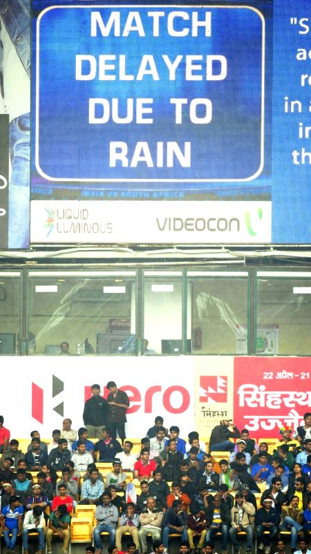 : Bengaluru: Audience wait at the stand as rain delay the start of the 2nd day of the second test match between India and South Africa at M Chinnaswamy Stadium in Bengaluru, on Nov 15, 2015. (Photo: ...