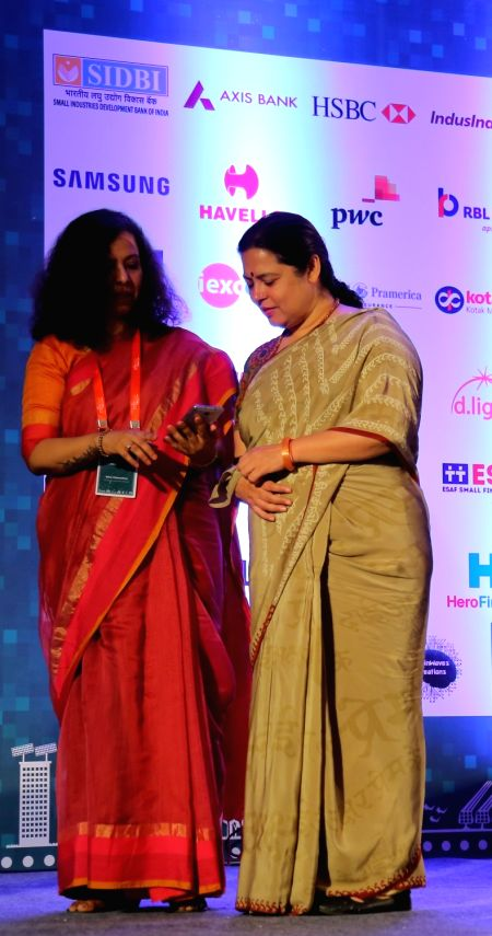 BJP MP Meenakshi Lekhi and MFIN CEO Ratna Vishwanathan launches a financial literacy mobile app for microfinance clients in New Delhi on April 26, 2017.