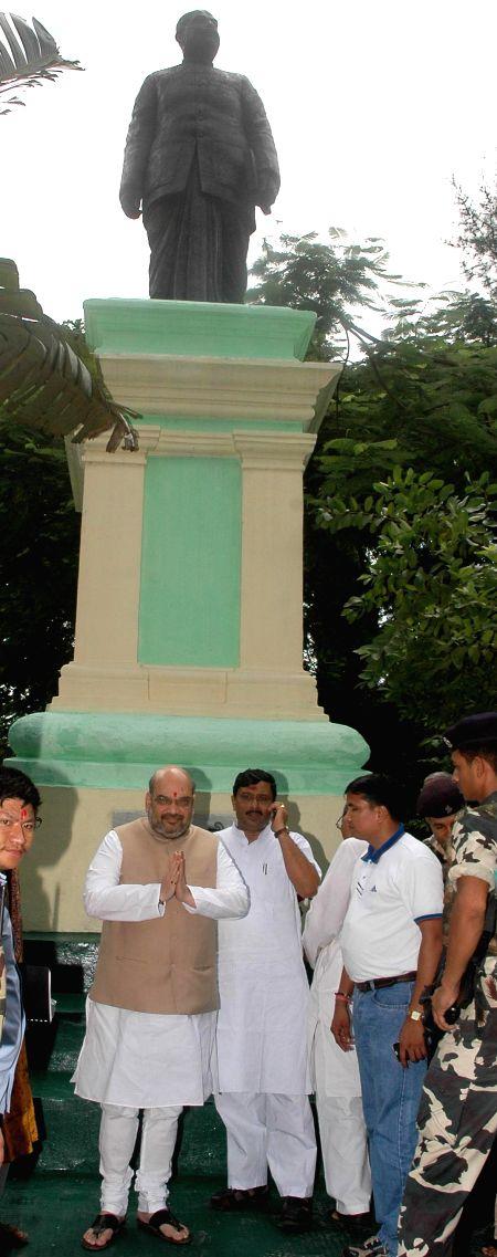 BJP president Amit Shah and West Bengal BJP chief Rahul Sinha after paying tribute to Shyama Prasad Mukherjee in Kolkata on Sept 7, 2014. - Rahul Sinha