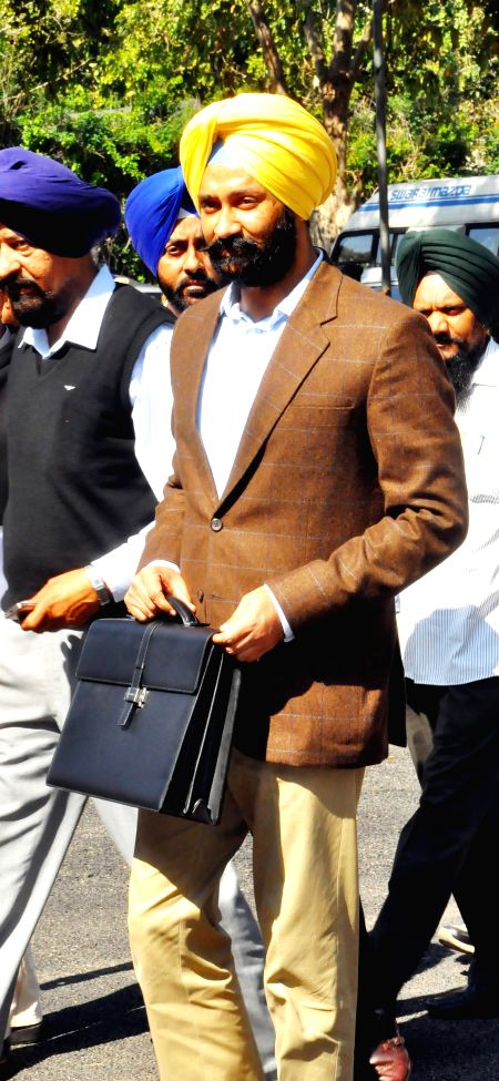 Punjab Finance Minister Parminder Singh Dhindsa arrives to present the state budget for 2015-16 at the state legislative assembly in Chandigarh, on March 18, 2015. - Parminder Singh Dhindsa