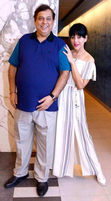 Filmmaker David Dhawan with Warda Nadiadwala during the screening of film Dishoom in Mumbai, on July 28, 2016. - David Dhawan