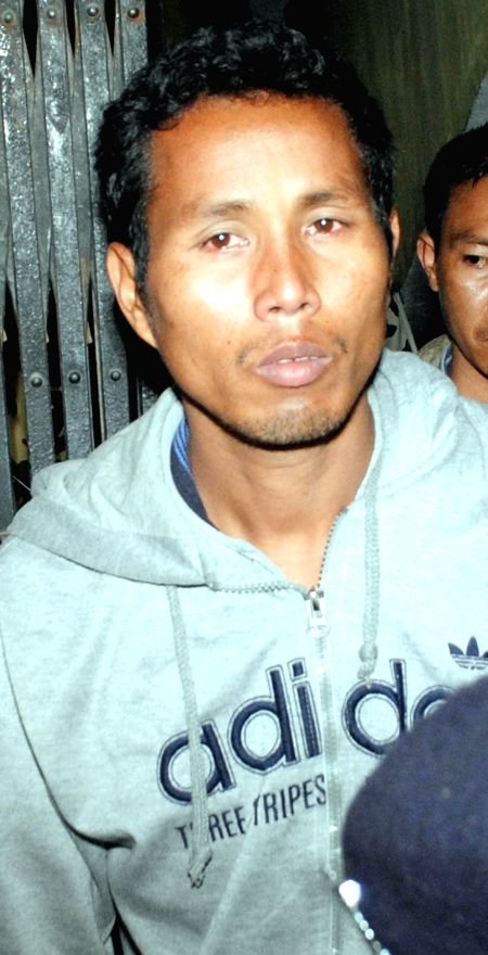 Senior Deputy Commander 14th Battalion of NDFB (S) Khamrei Basumatary alias Udla being taken to be produced at a Guwahati court on Jan 16, 2015. He was arrested from Kohima by National ...