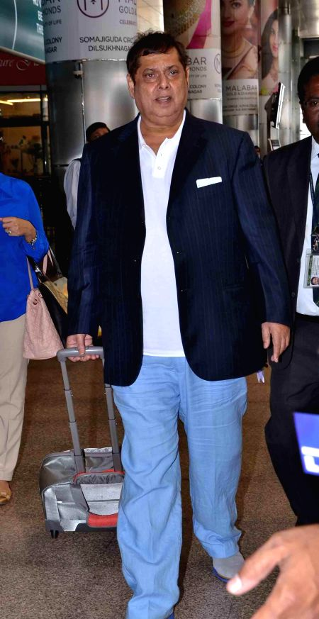 Film director David Dhawan arrive at Shamshabad Airport to attend wedding ceremony of Salman`s sister in Hyderabad.