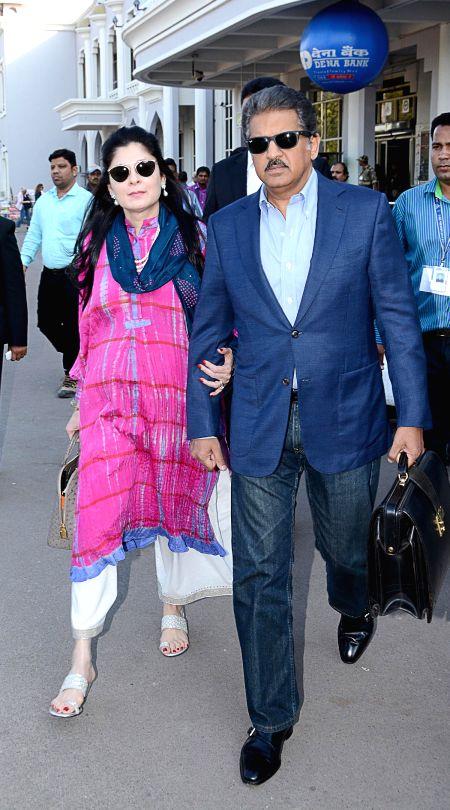 Chairman and managing director of Mahindra Group Anand Mahindra with his wife Suchitra Mahindra arrives at Jodhpur on Nov 29, 2014.