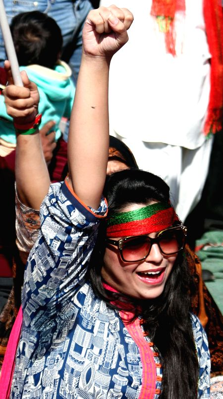 A supporter of Pakistani politician Imran Khan shouts slogan during an anti-government protest in southern Pakistani port city of Karachi on Dec. 12, 2014. Pakistan
