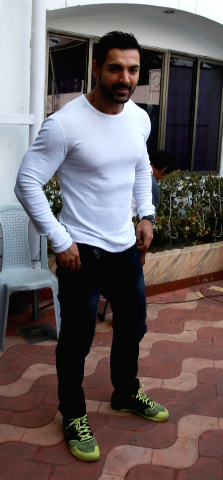 Caption:Actor John Abraham during the music launch of `Open Tee Bioscope` in Kolkata, on Dec 11, 2014.
