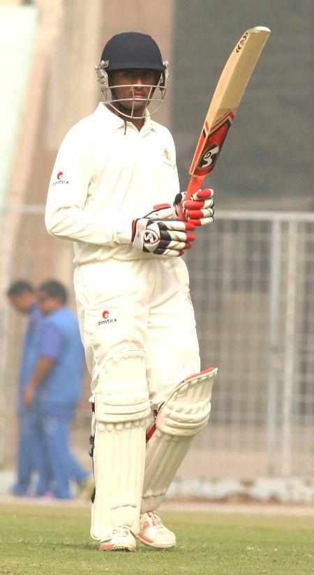 Karnataka batsman Shreyas Gopal raises his bat after scoring a century during a Ranji Trophy match between Karnataka and Bengal in Kolkata, on Dec 15, 2014. - Shreyas Gopal