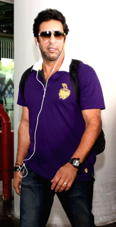 Kolkata Knight Riders bowling coach Wasim Akram arrives at Netaji Subhas Chandra Bose Airport in Kolkata on May 3, 2015.