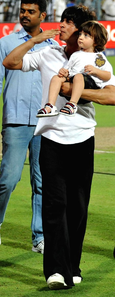 Kolkata Knight Riders (KKR) co-owner and actor Shah Rukh Khan with his son AbRam at the Eden Gardens during an IPL-2015 match between Kolkata Knight Riders and Mumbai Indians in Kolkata, on ... - Shah Rukh Khan