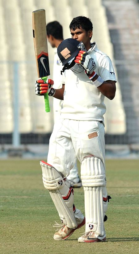 Mumbai batsman Shreyas Iyar celebrates after scoring a century during a Ranji trophy  match against Bengal at Eden Garden in Kolkata on Dec 28, 2014. - Shreyas Iyar