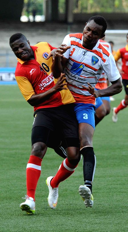 Players in action during an I-League cup match between East Bengal and Mumbai FC at Salt Lake stadium in Kolkata, on April 18, 2015. Score: 1-1.