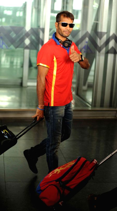 Royal Challengers Bangalore (RCB) player Ashok Dinda arrives at Netaji Subhas Chandra Bose Airport in Kolkata on April 6, 2015.