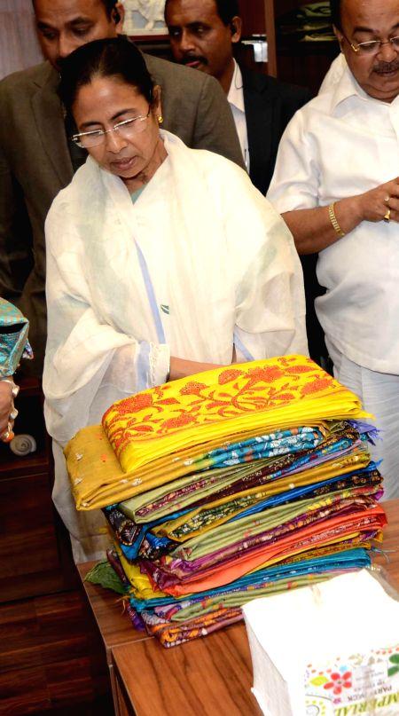 West Bengal Chief Minister Mamata Banerjee  at `Biswa Bangla Biponi Stall` after inaugurating it at Netaji Subhas Chandra Bose International Airport in Kolkata, on Feb 19, 2015. - Mamata Banerjee