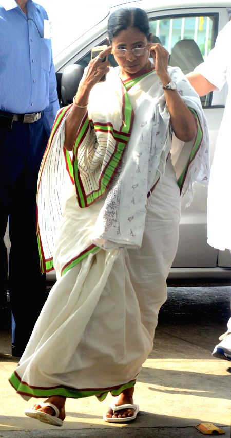 West Bengal Chief Minister Mamata Banerjee arrives at Netaji Subhas Chandra Bose International Airport as she returns back from her Bangladesh tour on Feb 22, 2015. - Mamata Banerjee