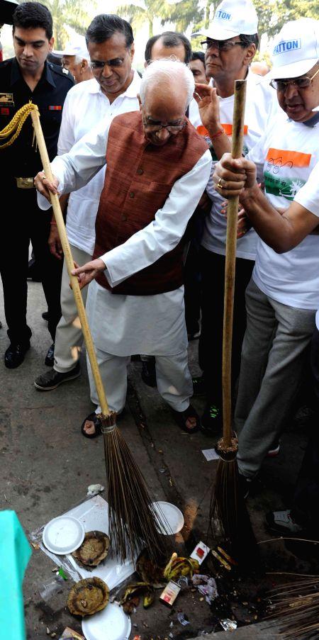 West Bengal Governor Keshari Nath Tripathi participates in Clean India Campaign in front of Victoria Memorial in Kolkata, on Nov 23, 2014. - Keshari Nath Tripathi