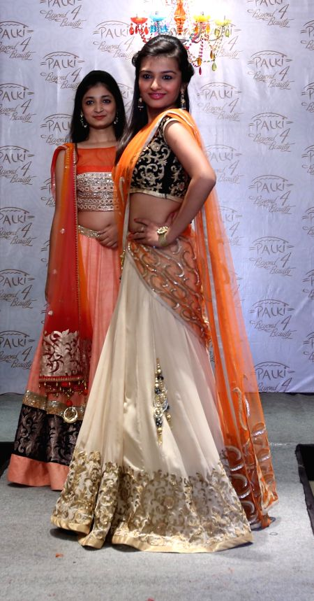 Models during a fashion show organised on the fourth anniversary of a renowned ethnic brand showroom in Kolkata on July 3, 2014.