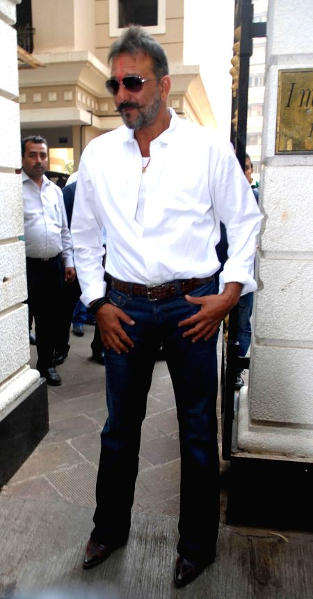 Actor Sanjay Dutt, who was granted furlough for 14 days, at his residence Imperial Heights, Pali Hill Bandra in Mumbai on Dec 24, 2014. The actor is currently serving the remaining of his ...