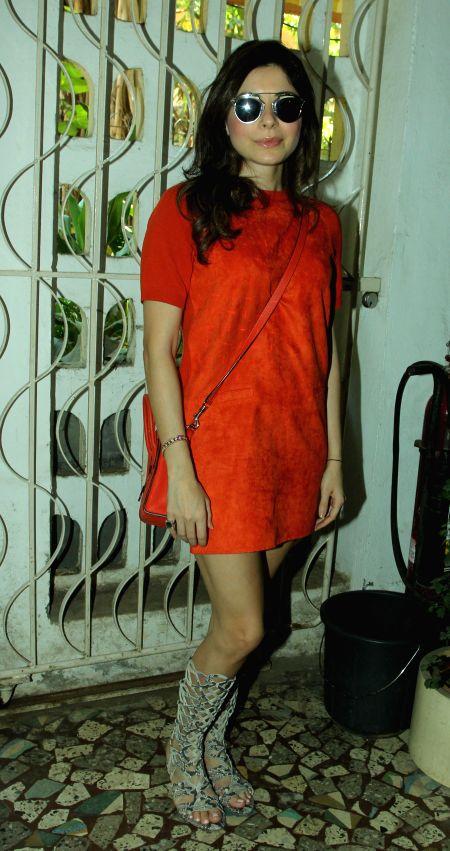 Singer Kanika Kapoor during the unveiling of Society magazine April issue, in Mumbai on March 31, 2015. - Kanika Kapoor