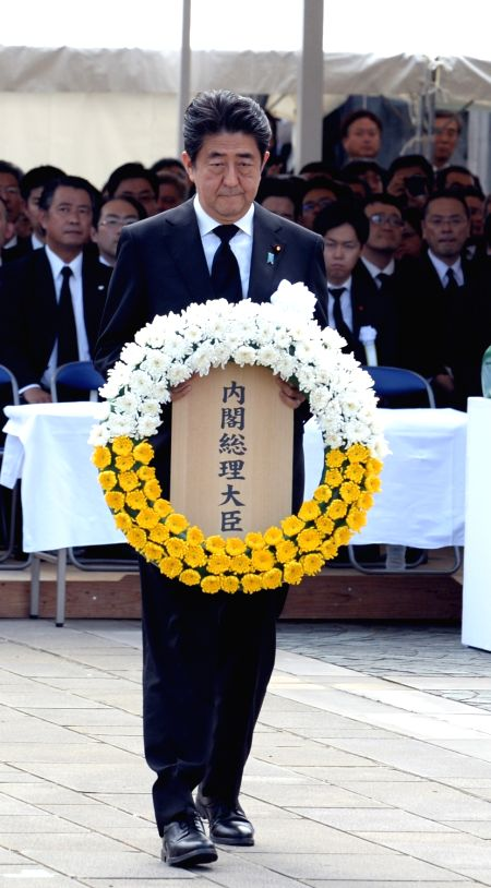 NAGASAKI, Aug. 9, 2016 - Japanese Prime Minister Shinzo Abe presents a wreath to atomic bombing victims during a ceremony commemorating the 71st anniversary of U.S. atomic bombing at the Peace Park ... - Shinzo Abe