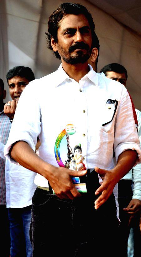 Nawazuddin Siddiqui during Dahi Handi festival at Politician Sanjay Nirupam`s Dahi Handi in Mumbai on August 29, 2013. - Nawazuddin Siddiqui