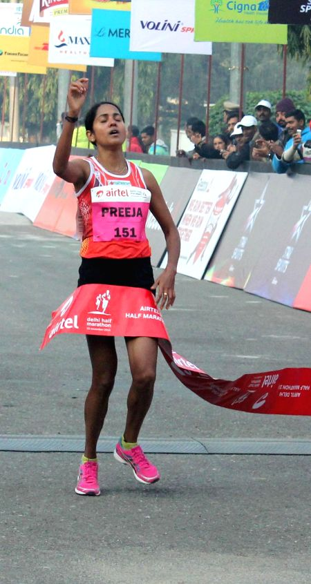 Indian runner Preeja Sreedharan wins the Airtel Delhi Half Marathon at Jawaharlal Nehru Stadium in New Delhi on Nov 23, 2014.