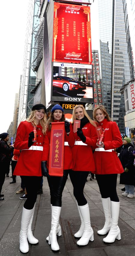 "Four models pose for photos during the ""Toast To Dreams"" Chinese New Year celebration in Times Square of New York, the United States, on Feb. 7, 2015.   ..."