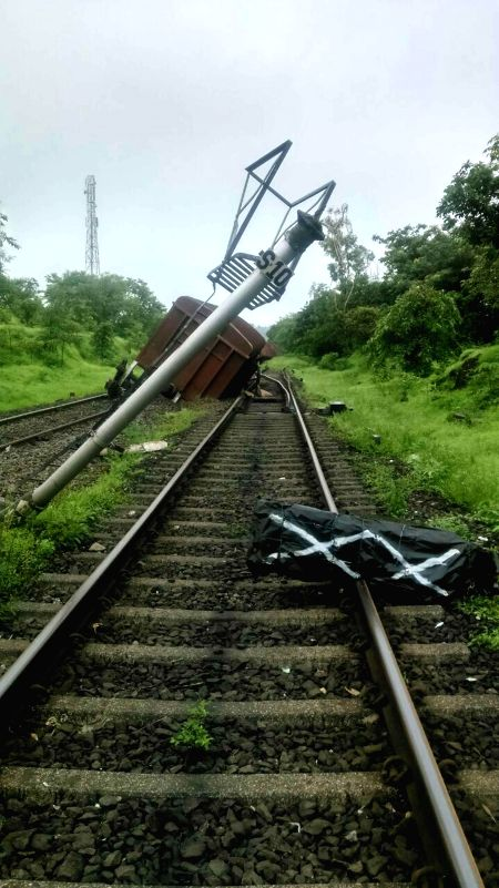 One wagon of the seven wagons of the Kota-Calicut train carrying a consignment of foodgrain which were derailed at Karanjadi, around 200 kms south of Mumbai, on Aug 24, 2014.