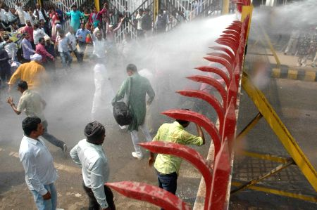 Police charge water cannons on teachers