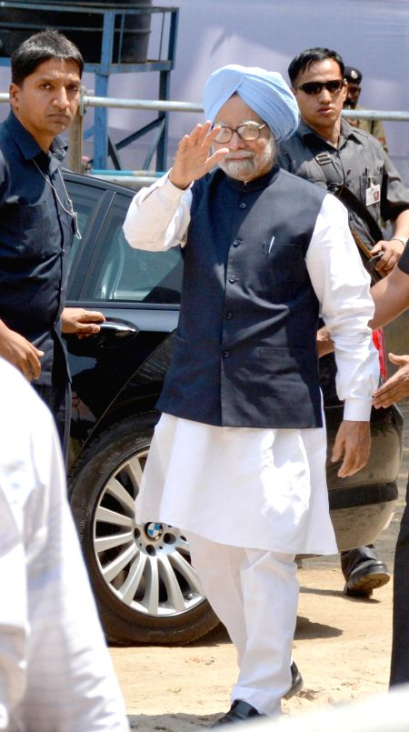Prime Minister Manmohan Singh after casting his vote during at a  polling booth during the sixth phase of 2014 Lok Sabha Polls in Guwahati on April 24, 2014.