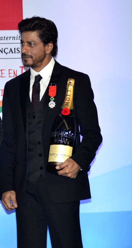 Shah Rukh Khan with Moet & Hennessy India Marketing Director Gaurav Bhatia after he was conferred the Knight of the Legion of Honour, France's highest honour for his outstanding contribution to ..