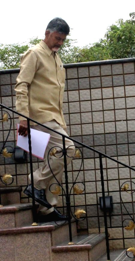 Telugu Desam Party (TDP) president N. Chandrababu Naidu arrives to address a press conference in Hyderabad on  May 8, 2014.