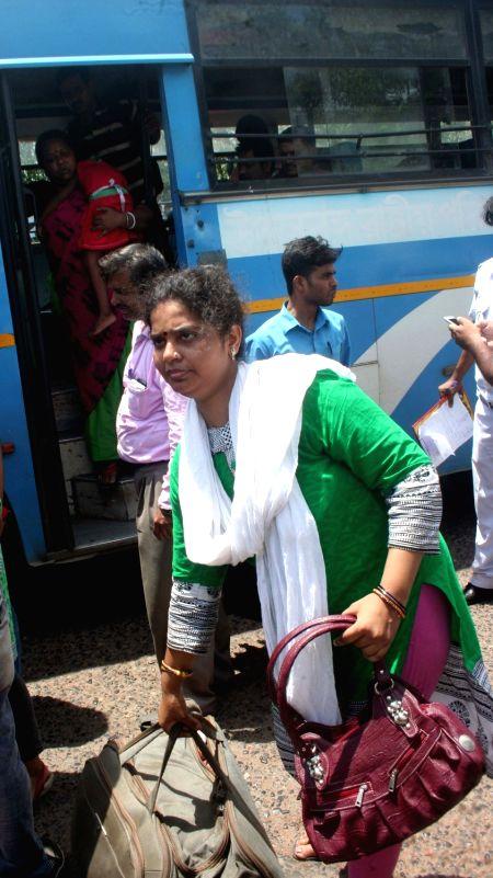 Tourists arrive in Kolkata from violence hit Darjeeling on June 10, 2017.