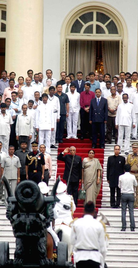 West Bengal Governor M.K.Narayanan and wife during his farewell ceremony at Raj Bhawan in Kolkata on July 4, 2014.
