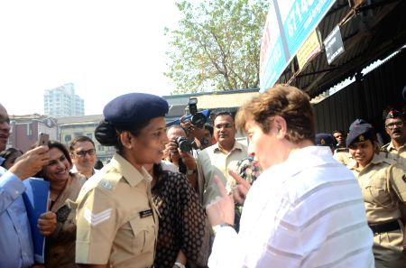 World Bank CEO interacts with woman police officer