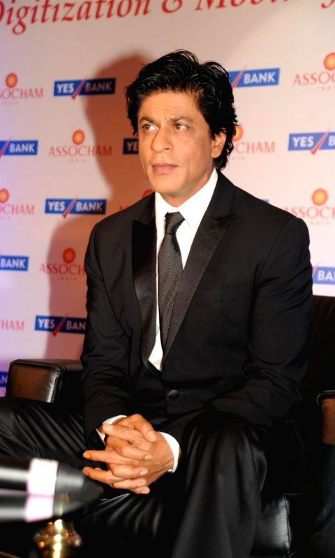 Actor Shah Rukh Khan during the launch of ASSOCHAM coffee table book on media and entertainment in Mumbai on Nov 23, 2015.