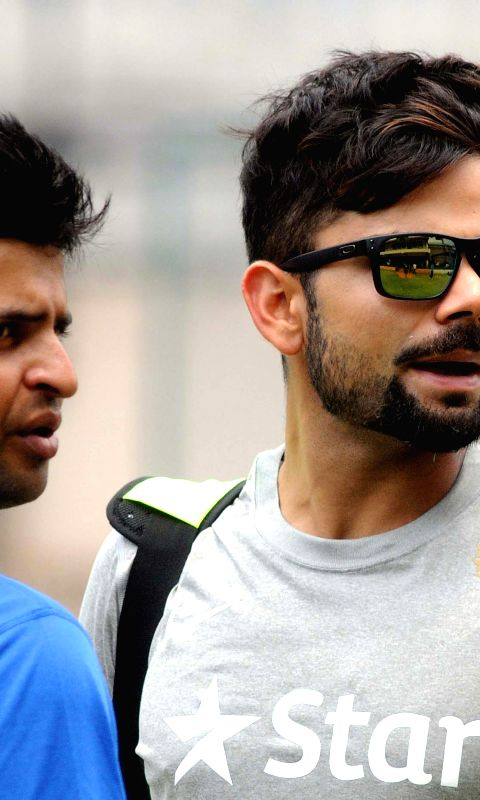 Indian cricketers Suresh Raina and Virat Kohli during the seven days preparatory camp for the upcoming series against South Africa at NCA, in Bengaluru on Sep 24, 2015.