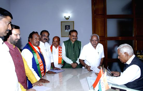 : Bengaluru: BJP's chief ministerial candidate in Karnataka B. S. Yeddyurappa along with party leaders Ananth Kumar, Prakash Javadekar and Muralidhar Rao, meets Karnataka Governor Vajubhai Vala ...(Image Source: IANS)