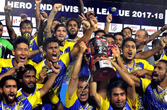 Bengaluru: Real Kashmir FC players celebrate after they won the 2017-18 2nd Division League at FSV Arena in Bengaluru on May 30, 2018. Real Kashmir FC became the first football club from Jammu and Kashmir to qualify for the country's top tier I-Leagu(Image Source: IANS News)