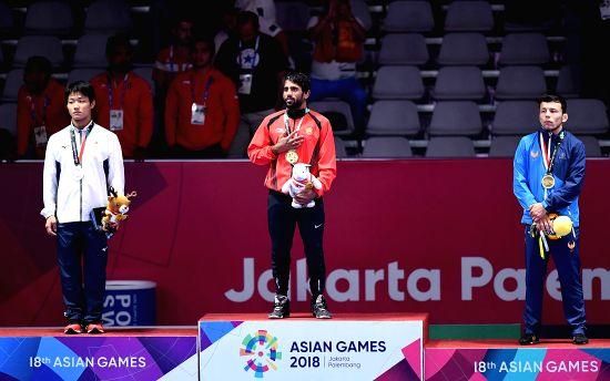 JAKARTA, Aug. 19, 2018 - Bajrang Bajrang (C) of India, Takatani Daichi(L) of Japan and Sirojiddin Khasanov of Uzbekistan during Men's Wrestling Freestyle 65 kg awarding ceremony at the 18th Asian ...(Image Source: Xinhua/Yue Yuewei/IANS)