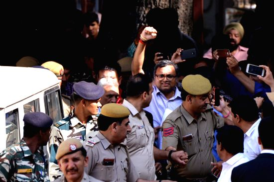 Karti Chidambaram, son of former Union Finance Minister P. Chidambaram being taken to be produced at Patiala House Courts in New Delhi on March 12, 2018. He has been sent to judicial ...